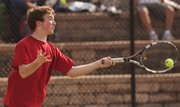 Lawrence High junior Thomas Irick smacks a forehand against Bishop Seabury on Thursday, March 28, 2013, at LHS.