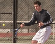 Bishop Seabury's Joe Simpson eyes a shot in a doubles match on Thursday, March 28, 2013, at Lawrence High.