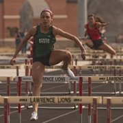 Free State's Alexa Harmon-Thomas leads her hurdles race during a meet on Thursday, March 28, 2013, at Lawrence High.