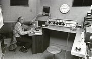 "Dr. James Seaver broadcasts the KANU 91.5 FM show ""Opera is My Hobby"" in 1977. This year, Kansas Public Radio is celebrating its 60th anniversary with events throughout the year."