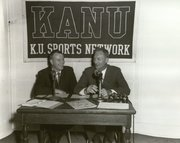 KANU Sports Director Tom Hedrick and then-Kansas University men's basketball coach Dick Harp broadcast on the KU Sports Network in the 1960s.