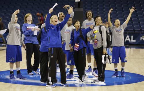 Members of the Kansas women's basketball team welcome their teammates during practice for the NCAA regional games in Norfolk, VA., Saturday, March 30, 2013.