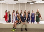 The Journal-World All-Area Girls Basketball Team, standing from left: Tyra Lyday, Ottawa; Alexa Gaumer, Bishop Seabury; Jenny Whitledge, Tonganoxie; Holly Ullery, Santa Fe Trail; Tanner Tripp, Mill Valley; Scout Wiebe, Free State; Stephanie Lichtenauer, Mill Valley; Katie Jones, Baldwin; and Megan Bonar, De Soto. Seated, from left: player of the year Kennedy Kirkpatrick, Free State, and coach of the year John McFall, Mill Valley.