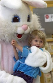 Caiista Irwin, 3, gets a hug from the Easter Bunny at Hy-Vee, 4000 W. Sixth St.