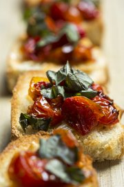 Roasted Garlic And Tomato Crostini is a treat with fresh basil.