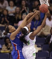 Kansas forward Carolyn Davis, left, and Notre Dame forward Ariel Braker (44) battle for a rebound during the first half of a regional semifinal of the NCAA Tournament on Sunday March 31, 2013, in Norfolk, Va.