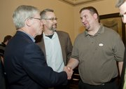 Mike Yoder/Journal-World Photo.From left, Lawrence mayor Bob Schumm, and city commissioner Aaron Cromwell, congratulate commissioner-elect Jeremy Farmer after Farmer won a seat on the city commission in Tuesdays election.