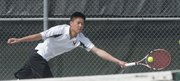Free State's Richard Lu reaches out for a return against Olathe Northwest during a singles match on Tuesday, April 2, 2013, at the Firebirds' home tennis quadrangular.