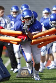 Kansas running back Taylor Cox prepares to head through the gauntlet during a spring practice on Tuesday, April 2, 2013, at Memorial Stadium.