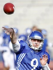 Kansas quarterback Jake Heaps throws a pass during a spring practice on Tuesday, April 2, 2013, at Memorial Stadium.