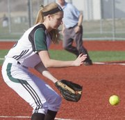 Free State High pitcher junior Meredith Morris fields a grounder against Leavenworth on Thursday, April 4, 2013, at FSHS.
