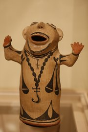 A ceramic human sculpture from the Cochiti Pueblo culture.