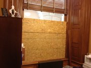 Boarded up window where man broke into state Rep. Tom Sloan's office in the Statehouse.