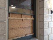 Outside view of broken window in state Rep. Tom Sloan's office.