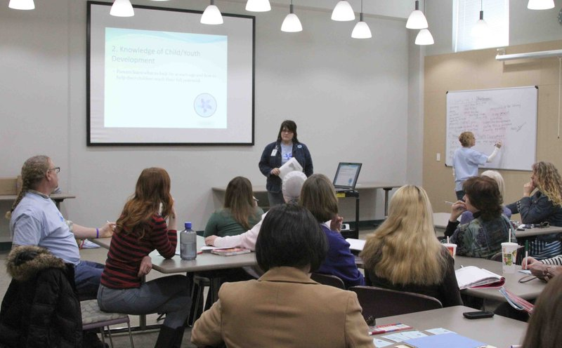 Jenn Preston, Healthy Families Douglas County supervisor, leads a training session for Strengthening Family Ambassador