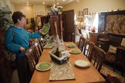 Lynn Thompson, Lawrence, finds a plate to her fancy at Amy's Attic Interiors and Antiques, 700 Locust St.