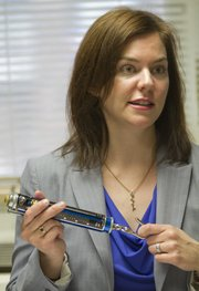 Jamie Simpson is the KU director of accessibility and Americans with Disabilities Act education. She started in March 2012 as the first person in her position at KU. One of the many things she monitors on campus is the opening force required for interior doors. Simpson displays an ADA door-opening force gauge which is used to ensure that the maximum opening force for an interior, non-fire rated door is no more than 5 pounds.