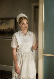 "Lawrence native Annie Tedesco plays the lead role of recently widowed hospital nurse Beth Milligan in the new TV series, ""Granite Flats."" Set in 1962, producers describe the show as a family-friendly period drama with a sci-fi twist."