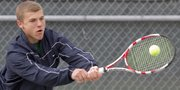 Free State senior Brandon Juracek returns a volley in the Firebirds' dual against Washburn Rural, Thursday, April 11, 2013, at FSHS. Juracek and senior teammate Miles Stevens competed as Free State's No. 1 doubles team.