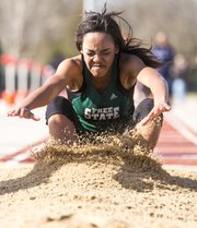 Free State's Gabbi Dabney lands as she competes in the long jump during a track meet hosted by Free State on Friday, April 12, 2013, at FSHS.