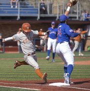 Texas'  Brooks Marlow is unable to beat the throw to first as Kansas' Alex DeLeon (34) makes the force out during Kansas' game against Texas, Saturday, April 13, 2013, at Hoglund Ballpark.