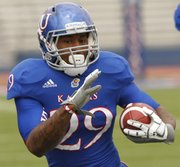 Kansas running back James Sims runs upfield during the KU spring football game on Saturday, April 13, 2013 during the KU football spring game. The Blue team defeated the White team, 34-7.