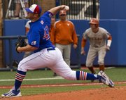 Kansas' Drew Morovick delivers a pitch as Texas' Weston Hall leads off of third base during Kansas' game against Texas Sunday afternoon at Hoglund Ballpark.