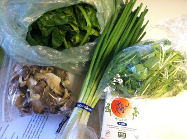 Dried mushrooms, spinach, green onions, tofu and salad greens.