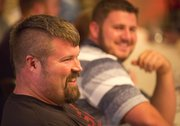 Christian Cantwell, foreground, and Joe Kovacs share a laugh during a dinner Tuesday, April 16, 2013, at the Eldridge Hotel in downtown Lawrence. The pair will compete today in the men's elite pro shot put event at the Kansas Relays at the Douglas County Fairgrounds.