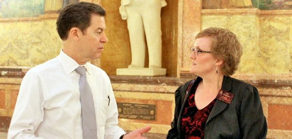 Gov. Sam Brownback talking with Anna Lambertson of the Kansas Medicaid Access Coalition last month at the Statehouse. The coalition delivered a petition with more than 2,700 signatures urging expansion of the state Medicaid program, which currently has among the tightest restrictions in the nation.