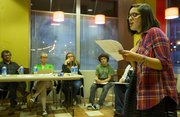 Thirteen-year-old Lauren Brittain, of Lawrence, reads a poem as judges watch during a poetry slam April 17 hosted by the Lawrence Public Library. Lauren won third place in the event.