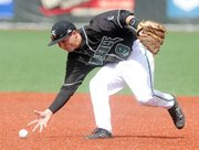 Free State second baseman Cooper Karlin bare-hands a grounder against Rogers (Ark.) High on Friday, April 19, 2013, at FSHS.