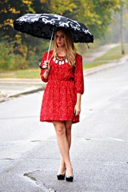 Elizabeth Kennedy models a black-and-white umbrella that adds detail and depth to an outfit while offering rain protection.