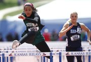 Free State hurdler Alexa Harmon-Thomas clears the final hurdle on her way to a first-place finish in the Girls 100 Meter Hurdles event of the Kansas Relays on Saturday, April 20, 2013 at Memorial Stadium. Nick Krug/Journal-World Photo