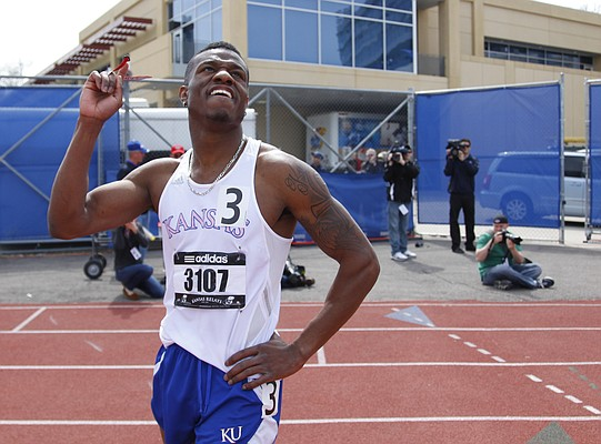 Kansas sprinter Kyle Clemons gives thanks after finishing first in the Mens' Invitational 400 Meter on Saturday, April 20, 2013 at Memorial Stadium. Nick Krug/Journal-World Photo