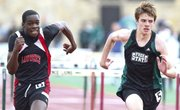 Lawrence High sophomore Dearion Cooper, left, and Free State senior Alex Heath sprint to the finish of the boys 110 meter hurdles on Monday, April 22, 2013 at Free State High School.