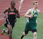 Lawrence High senior John Mwithiga, left, and Free State sophomore Erik Howland keep tight company in the first leg of the boys 4x800 meter relay of the Free State Invitational on Monday, April 22, 2013 at Free State High School.