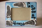 A ceramic picture frame decorated with baby footprints at Sunfire Ceramics ($18 includes frame and paint fee).