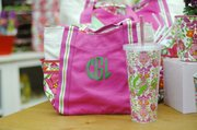 A Vera Bradley tote and plastic tumbler, both with custom monograms, from Prairie Patches.