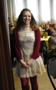 Taylor Moldenhauer smiles as she walks up to be honored with the Wallace Galluzzi 2012 Outstanding Youth Volunteer Award during the Celebration of Volunteers! event Tuesday at the Carnegie Building in Lawrence.