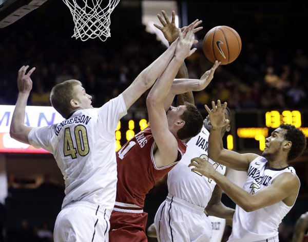 Arkansas forward Hunter Mickelson, second from left, loses the ball as he tries to shoot among Vanderbilt defenders Josh Henderson (40), Dai-Jon Parker (24) and Kevin Bright, right, during the first half on Saturday, Feb. 9, 2013, in Nashville, Tenn.