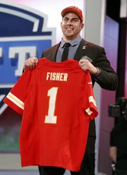 Tackle Eric Fisher from Central Michigan holds up the team jersey after being selected first overall by the Kansas City Chiefs in the first round of the NFL football draft, Thursday, April 25, 2013 at Radio City Music Hall in New York.