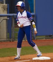 Kansas' Alex Hugo lets out a yell as she makes it safely into third base during the first game of Kansas' double header against Baylor Saturday at Arrocha Ballpark.