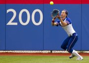 Kansas' Maggie Hull pulls in a pop fly  during the first game of Kansas' double header against Baylor Saturday at Arrocha Ballpark.