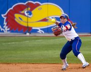 Kansas' Chaley Brickey fires a throw to first base during the first game of Kansas' double header against Baylor Saturday at Arrocha Ballpark.