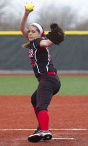 Lawrence High's Megan Sumonja delivers a pitch during Lawrence High's game against Olathe North Saturday at Free State.