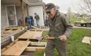 Eudora resident Eugene Westerhouse, 85, along with nine volunteers, build a wheelchair ramp at a home in Eudora. Most men Westerhouse's age would be using the ramps, but for the last 35 years, he's helped build over 300 of them.