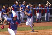 Kansas' Cassen Salamone, center, claps as she heads home to score a run while teammate Mariah Montgomery sprints towards first base while the Kansas dugout cheers during Kansas' game against Baylor Sunday afternoon at Arrocha Ballpark.