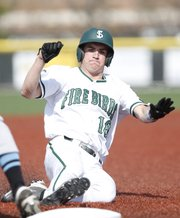 Free State runner Sam Hearnen slides safetly into third base during the second inning against Shawnee Mission East on Monday, April 29, 2013 at Free State High School. Nick Krug/Journal-World Photo