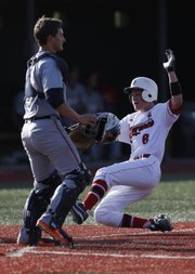 Lawrence High runner Ryan Walter slides past Olathe East catcher Grant Spillers to score during the third inning against Olathe East, Tuesday, April 30, 2013 at Lawrence High School. Nick Krug/Journal-World Photo